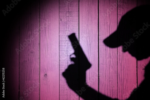 Silhouette of a man with a handgun, XXXL image