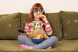 little girl with 3d glasses eat chips and watching tv