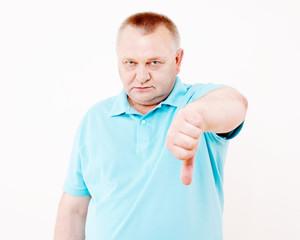 Senior man showing thumb down over white