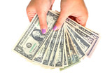 Dollars in female hands isolated over white