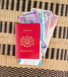 Malaysian passport with Hong Kong currency