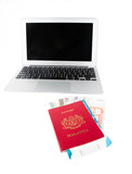 Passport with Philippine currency and laptop