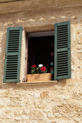 Old Shutter windows with a flowers.