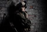 Dramatic portrait of a beautiful girl in uniform.
