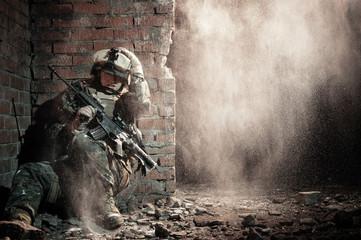 U.S. marine hiding from explosion