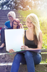 Girls learning in colourful light