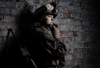 Dramatic portrait of a beautiful girl in uniform.