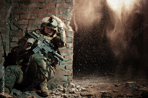U.S. marine hiding from explosion