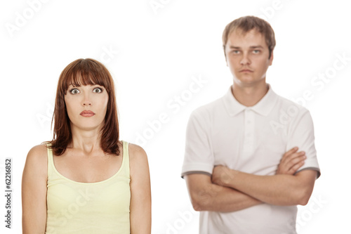 Closeup portrait of young couple,isolated on white background.