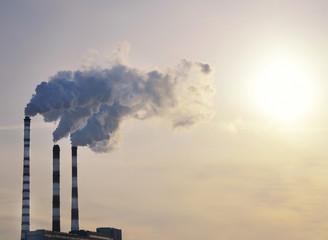 industrial smoke on sunset
