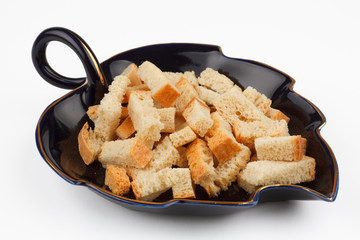 hill of wheat rusks on a black saucer