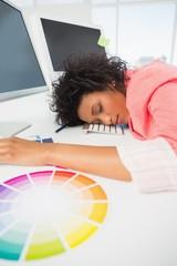 Female artist with head resting on keyboard