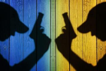 Silhouette of a man with a handgun, XXXL image