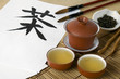 Tea ceremony set with hieroglyph 'Tea' and calligraphic brushes