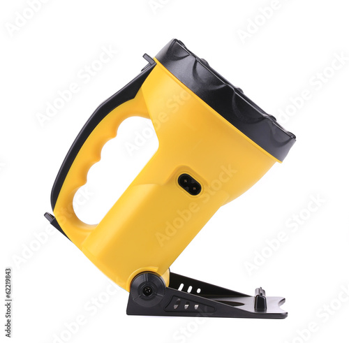 Yellow plastic pocket handle flashlight.