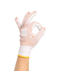 Garden gloves showing a ok sign.