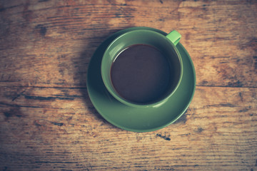 Cup of black coffee on table