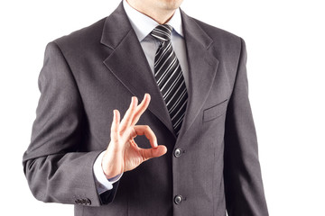 A business man showing an ok sign