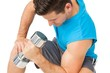 Close-up of a fit man exercising with dumbbell