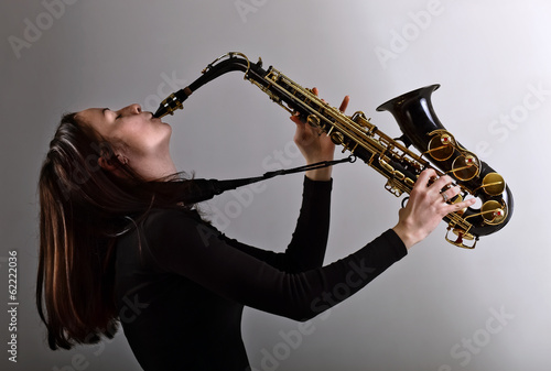 woman in black with saxophone