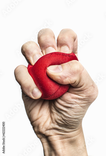 Hand of stressed man squeezing ball