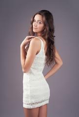 Lovely woman in white elegant dress