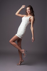 Beautiful expressive woman in white elegant dress