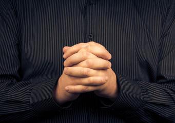man wearing shirt folded hands