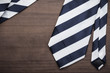 black and white striped necktie on wooden table