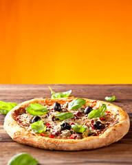 Fresh italian pizza on wood