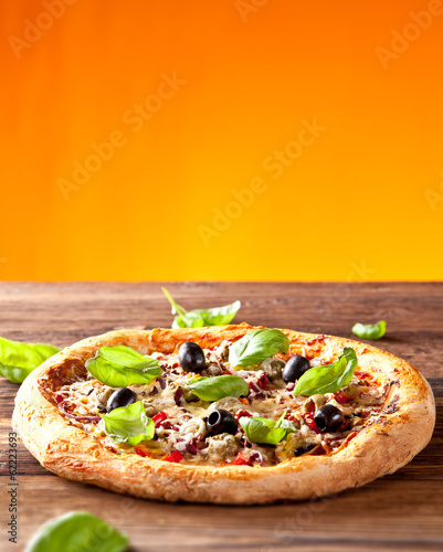 Fresh italian pizza on wood