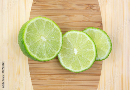 Three Slices Of Tart Green Limes Up Close