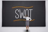 Businesswoman considering the word swot