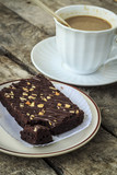 chocolate brownies with coffee cup on table
