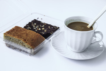 coffee break with cake banana and chocolate brownies