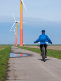 Mountain biker riding near wind turbine