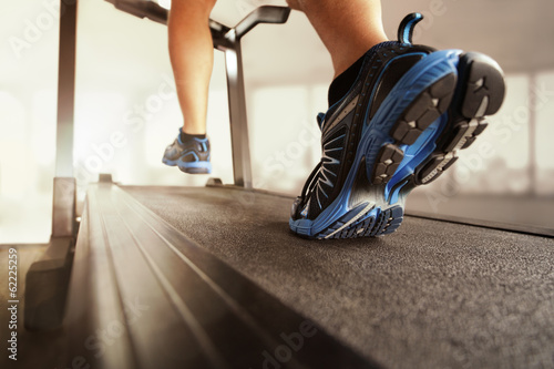 Running on treadmill - 62225259
