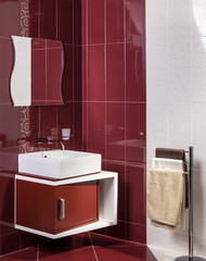 Interior of modern bathroom with sink and cabinet