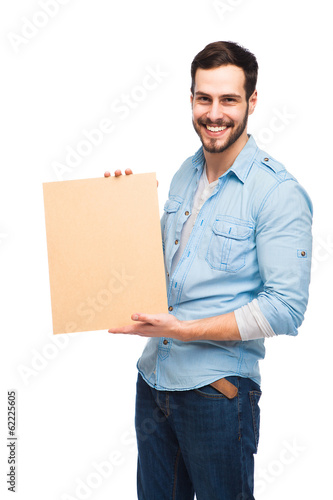 Young handsome man casual dressed with blank wooden panel