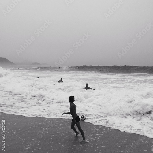 a boy plays with ball on copacabana beach Rio de Janeiro, Brazil