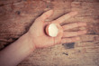 Hand holding an egg shell