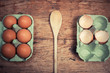 Wooden spoon and trays with eggs