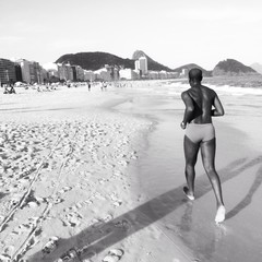Man is running on copacabana beach, Rio de Jaineiro, Brazil