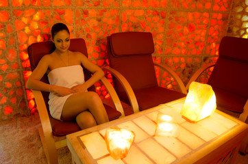Beautiful girl healing in the salt room.