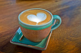 cup of coffee, with heart shape on wood background