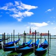 Famous gondolas of Venice, Italy with vibrant blue sky