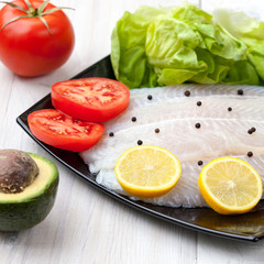 preparing fish filets for grilling