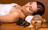 Fototapety beautiful brunette in a massage parlor