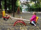 Little girl with teddy bear on playground