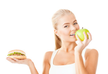smiling woman with apple and hamburger